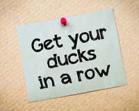 Get your ducks in a row. Message. Recycled paper note pinned on cork board. Concept Image Stock Images