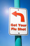 Get Your Flu Shot. Conceptual Sign against Blue Sky. Conceptual traffic sign with the text 'Get Your Flu Shot'. Concept of health care and prevention Stock Photography