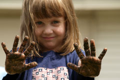 Get your hands dirty. This girl has been playing in the dirt.  If you want to get a job done, you have to get your hands dirty Stock Images