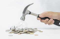 Get your money back. Lost money too much with incandescent lamp, so change it like a hammer smash to get your money back stock image