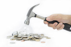 Get your money back. Lost money too much with incandescent lamp, so change it like a hammer smash to get your money back stock photography