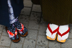 Geta traditional Japanese footwear. Close up of mother and daughter wearing kimono and geta traditional Japanese footwear stock photography