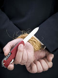 The getaway. Closeup on a businessman's hands trying to set himself free Stock Images