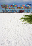 Getaway Island Paradise. Is Chairs And Umbrellas On A Deserted Beautiful White Sandy Beach Stock Photography