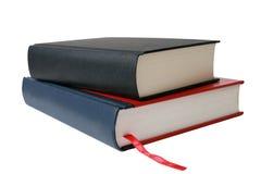 Getrennte Bücher über Weiß. Stockfoto