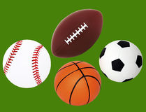 Getrennte Baseball-, Fußball-, Basketball-und Fußball-Kugel Stockbild