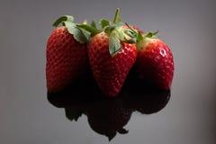 Getrennte Erdbeeren Stockbilder
