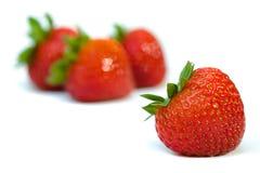 Getrennte Früchte - Erdbeeren Stockbild