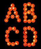 Getrennte Kerzeleuchte-Alphabetserie Stockfoto