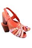 Getrennte orange Schuhe Stockbild