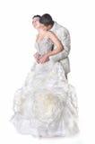 Getrennter Bräutigam küßt seine Braut auf einem Stutzen Lizenzfreies Stockbild