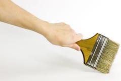 Getrennter Malerpinsel und Hand Lizenzfreie Stockfotografie