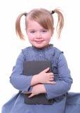 Getrenntes Mädchen mit einem Buch Lizenzfreies Stockfoto
