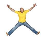 Getrenntes Mannspringen Stockfoto