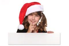 Getrenntes Weihnachtskind-Holding-Zeichen auf Weiß Lizenzfreie Stockfotos