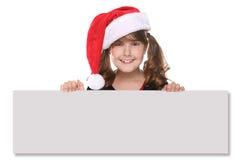 Getrenntes Weihnachtskind-Holding-Zeichen auf Weiß Stockfoto