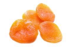Getrocknete Aprikosen lokalisiert auf weißem Hintergrund stockbild