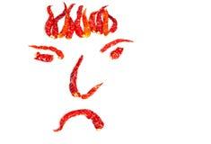 Getrocknete glühende Paprikas in einer Gesichtsform Stockfotografie