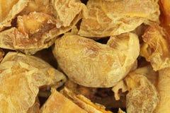 Getrocknete Pfirsichhandvoll Goldhintergrund Lizenzfreies Stockbild