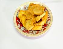 Getrocknete Steckfassungsfruchtchips im Plättchen Stockfoto