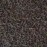 Getrockneter Hintergrund des schwarzen Tees Stockbild