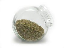 Getrocknetes Oregano in einem Glas Lizenzfreie Stockfotos