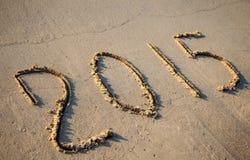 2015 getrokken op zand Stock Afbeeldingen