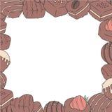 Getrokken vectorillustratiegrens met chocolade behandelde pralines stock illustratie