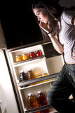 She Searches Fridge For Late Night Snack Stock Image