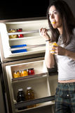 She gets Into the Fridge Late Night Snack Royalty Free Stock Photography