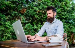 Getting access to an online education. University student studying online. Adult learner training through online courses. Or webinar. Bearded man shopping stock photos