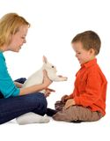 Getting acquainted with a bunny. Mother introducing a bunny to her young child (easter theme, isolated royalty free stock photo