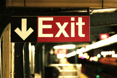 Getting Away From It All. Exit sign in subway station Royalty Free Stock Photo
