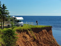 Getting Away From It All. RV vehicle and Traveller on Prince Edward Island, Canada Royalty Free Stock Photos