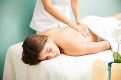 Getting back massage at a spa clinic Royalty Free Stock Photos