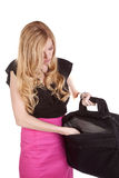 Getting in bag. A business woman reaching for something she needs in her bag Royalty Free Stock Photography