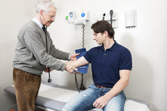 Getting Blood Pressure Checked Stock Photography