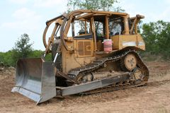 Getting Busy. Bull dozer ready for land clearing and clean up Royalty Free Stock Photos