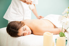 Getting a candle massage at the spa stock photography