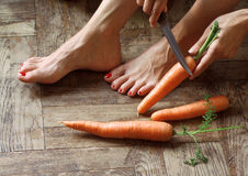 Getting the carrots ready Royalty Free Stock Photography