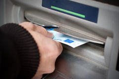 Getting cash at ATM machine Stock Photos