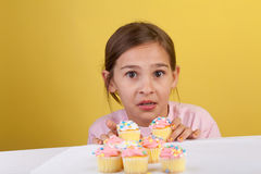 Getting caught stealing cupcakes Royalty Free Stock Images