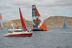 Getting Close To The Start Boat - Volvo Ocean Race Sailing Yachts In Yachting Event Stock Photos
