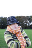 Getting colder. A woman in autumn-winter with scarf and hat feeling cold Royalty Free Stock Photos