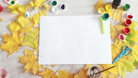 Getting creative process, preparation. Autumn leaves and items for creativity stock footage