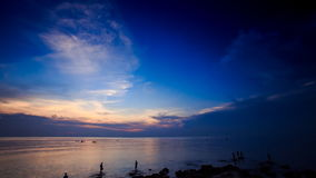 Getting Dark above Sea Silhouettes of People Boats after Sunset stock video footage
