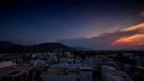 Getting Dark above Tropical Resort City at Sunset stock footage