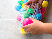 Getting dirty plastic ball in a net bag.  royalty free stock images
