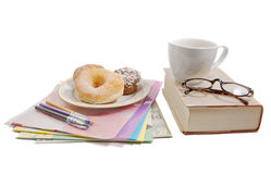 Getting down to work, with donuts Royalty Free Stock Images
