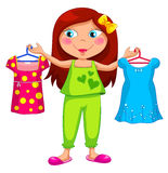 Getting dressed. Little girl holding different outfits Stock Photography